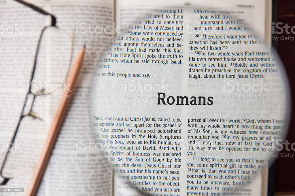 the book of Romans Reading The New International Version stock photo