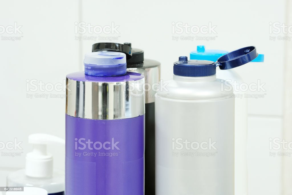 The bottles with shampoo and other perfume stock photo