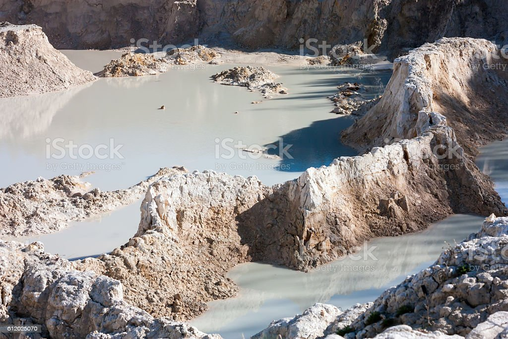 The bottom of the abandoned white clay quarry royalty-free stock photo