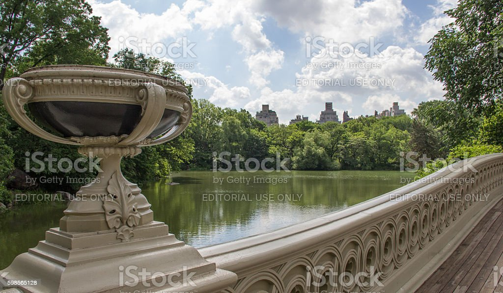 The bow bridge in Central Park under blue skies stock photo