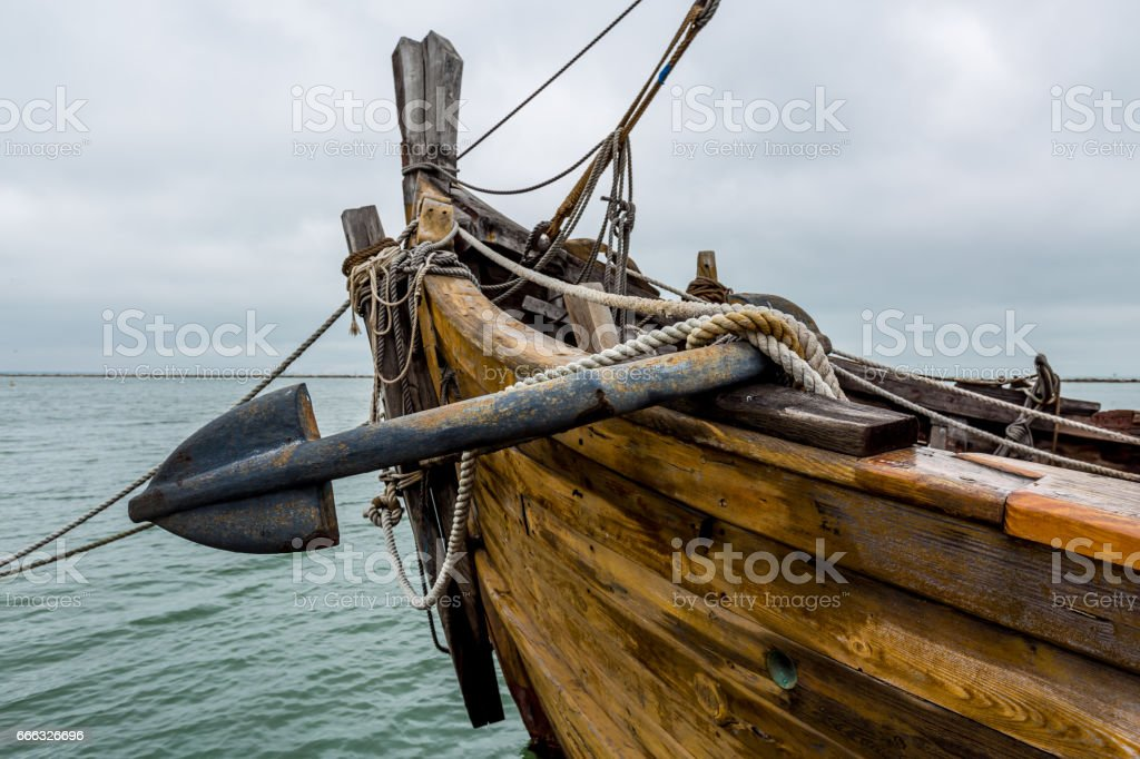 The Bow with Anchor of Old Sailing Ship. stock photo