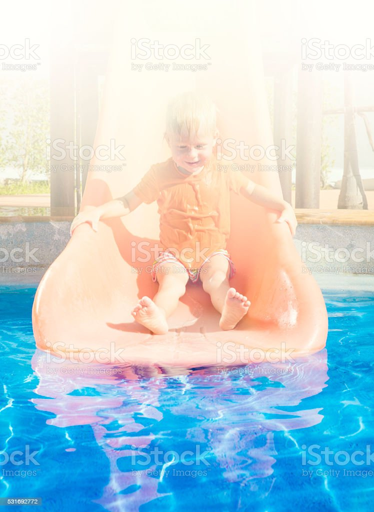 The boy at a water park stock photo
