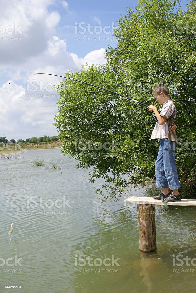 The boy on fishing royalty-free stock photo