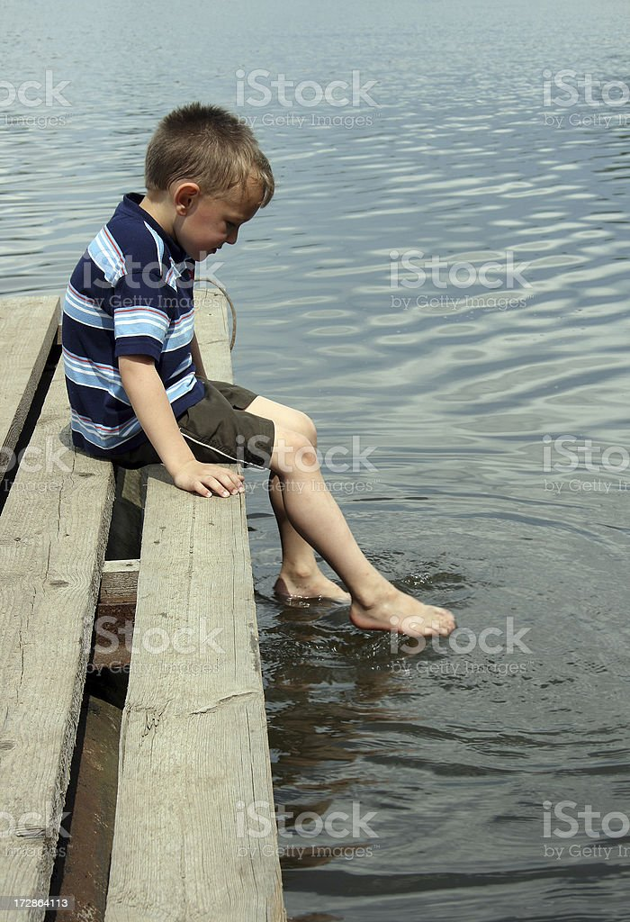 The boy on quay royalty-free stock photo