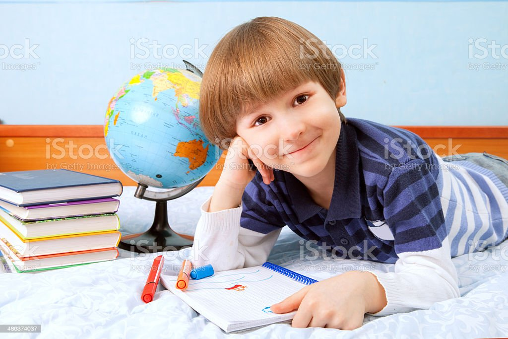 The boy paints in sketch-book royalty-free stock photo