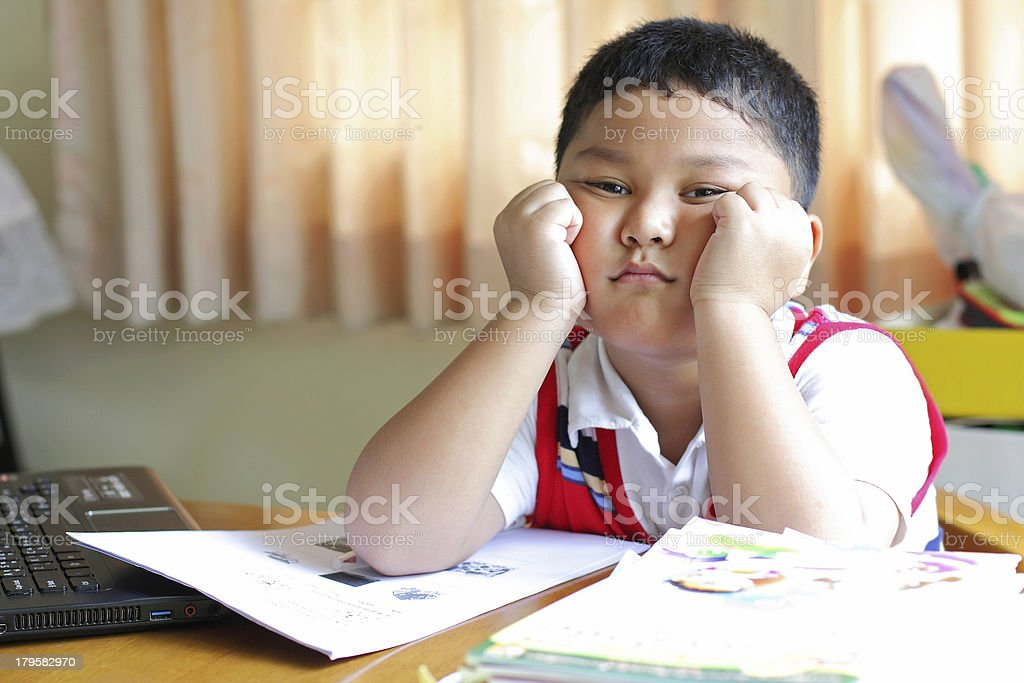The boy tired of homework. royalty-free stock photo