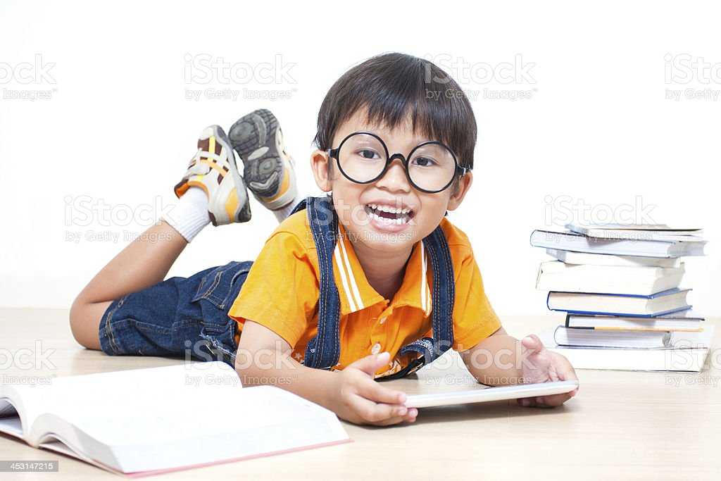 The boy using tablet stock photo