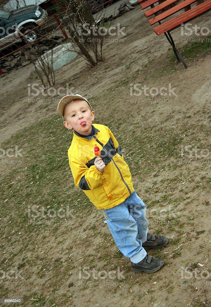 The boy with ice-cream stock photo