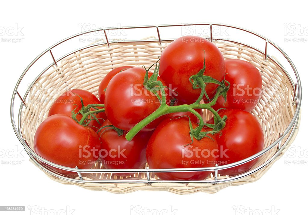 The branch of cherry tomatoes in a wooden bowl, isolated royalty-free stock photo
