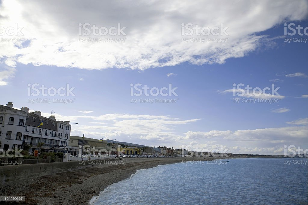 The Bray waterfront with a beach, homes, and businesses. stock photo