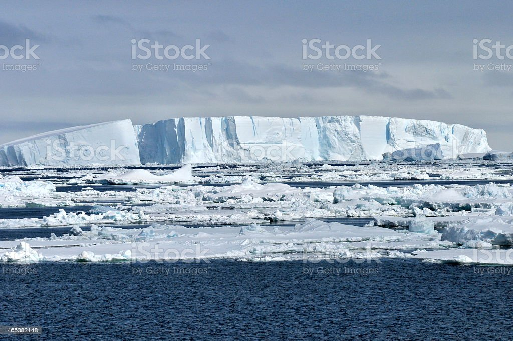 The breaking iceberg in Antarctica water stock photo
