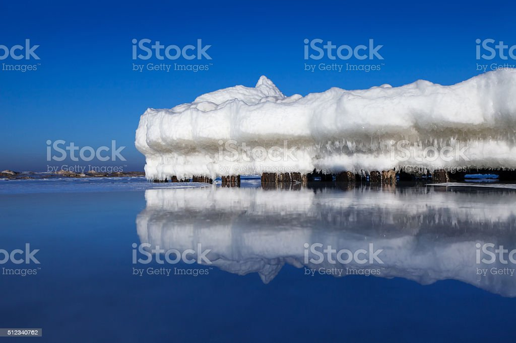 the breakwater in the form of an iceberg stock photo