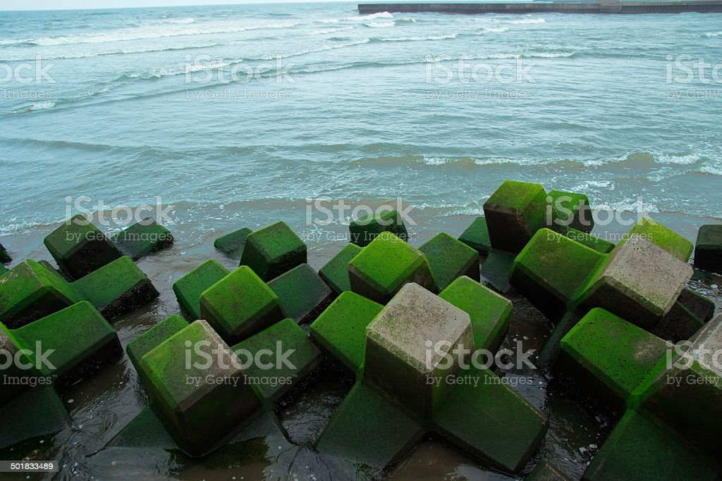 The breakwater is covered to sand royalty-free stock photo