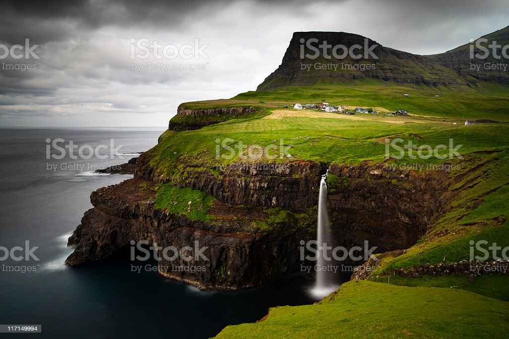 The breath taking view of Gasadalur with a waterfalls stock photo