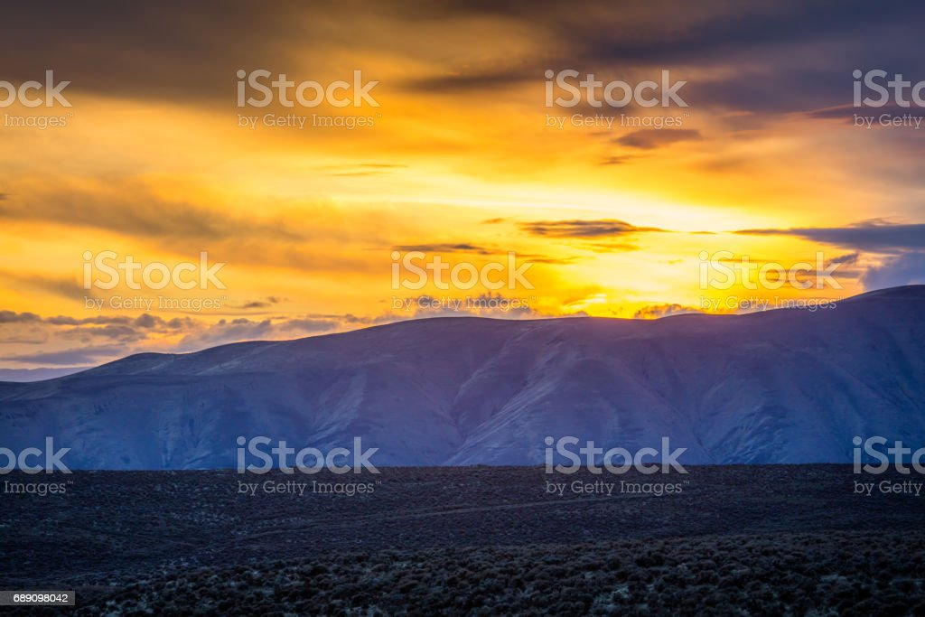 The breathtaking views of the valley. The last rays of the sun illuminate the mountains. stock photo