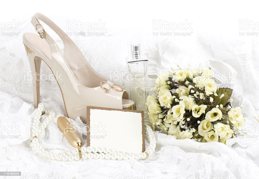 The bridal shoe, flowers and wedding rings. royalty-free stock photo