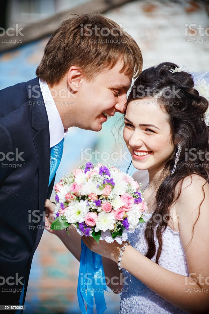 The bride and groom are rolled with laughter, giggle, laugh stock photo
