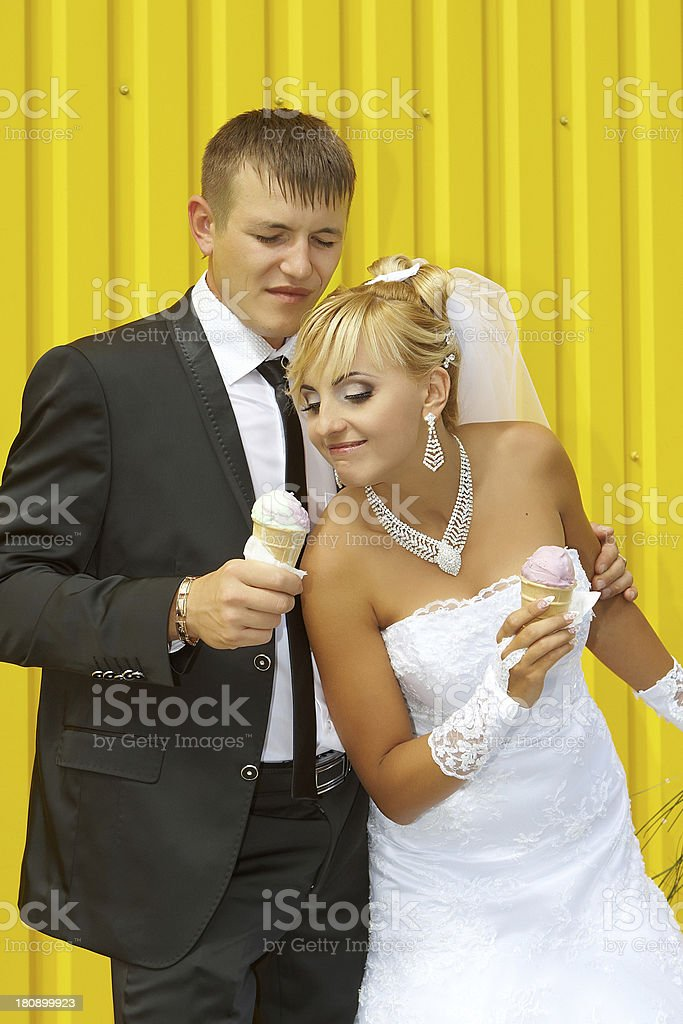 the bride and groom eat ice cream royalty-free stock photo