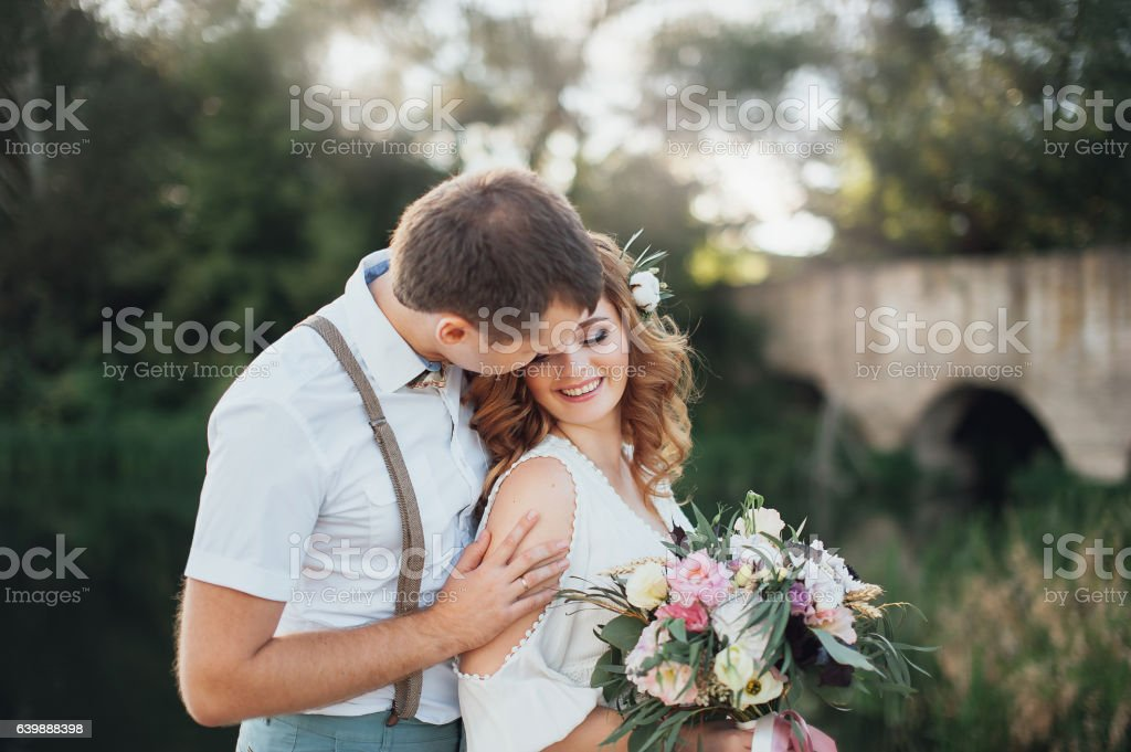 The bride and groom in nature. Rustic Wedding stock photo