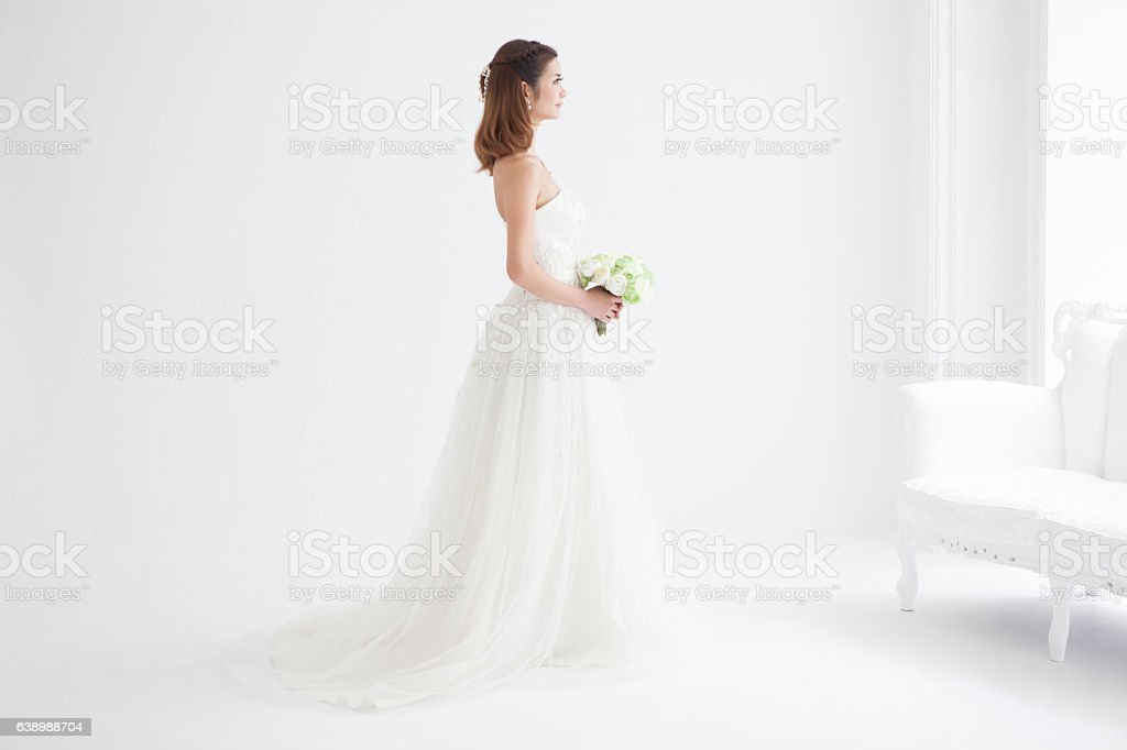 The bride has a bouquet of flowers. stock photo