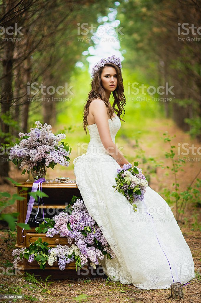 the bride in the wood stock photo