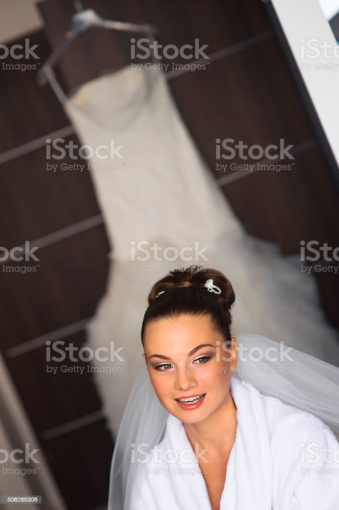 The bride is speaking to the visagist. stock photo