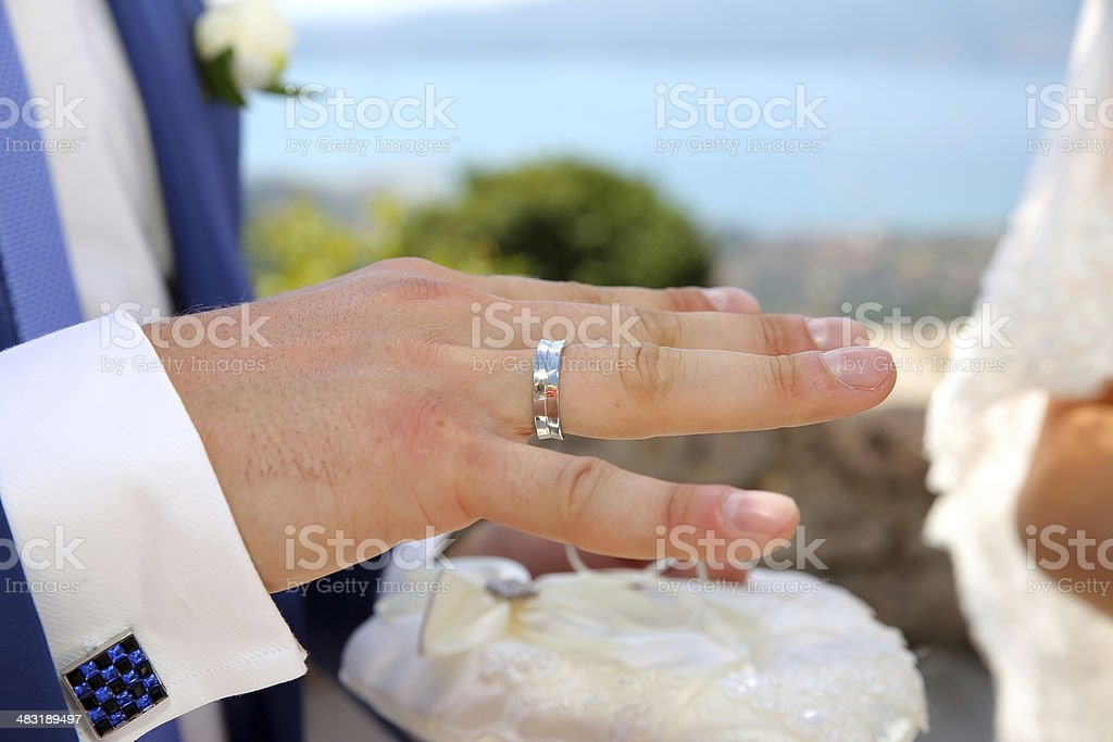 The bride puts on a wedding ring royalty-free stock photo