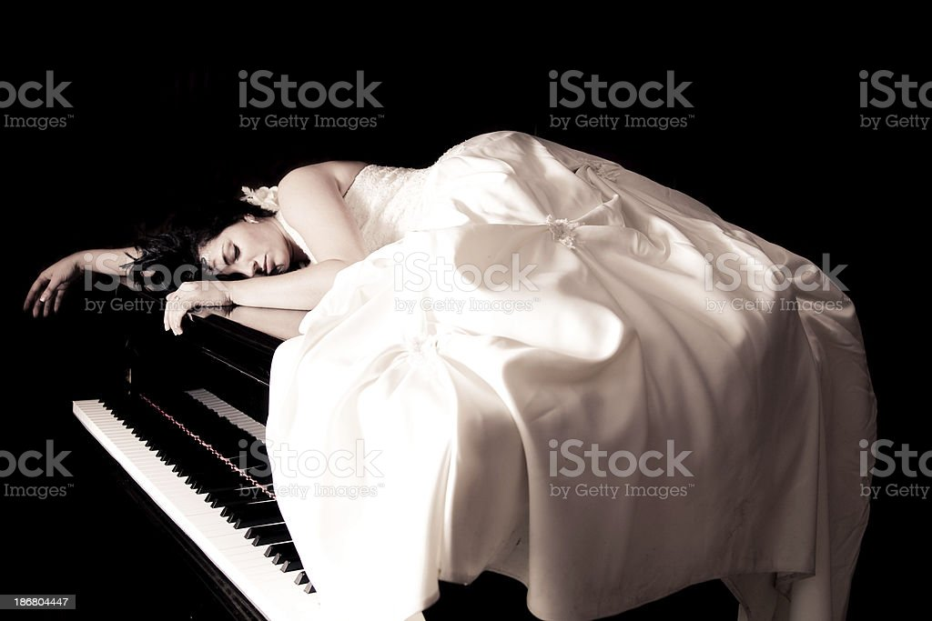 The bride sleeping on a piano royalty-free stock photo