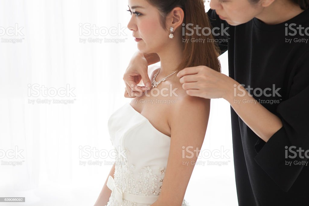 The bride wears a beautiful necklace. stock photo