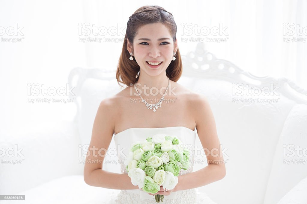 The bride wore a wedding dress. stock photo