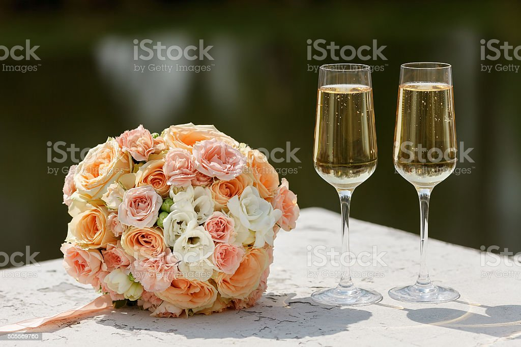 the bride's bouquet and two champagne glass stock photo