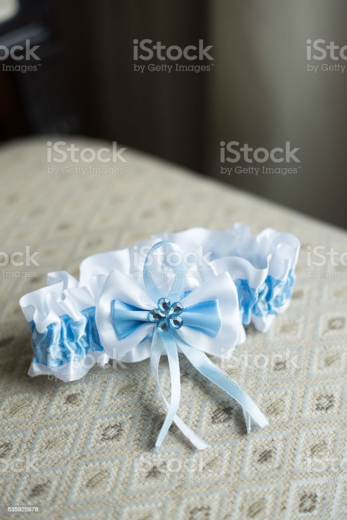 the bride's garter with a blue strip stock photo