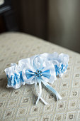 the bride's garter with a blue strip