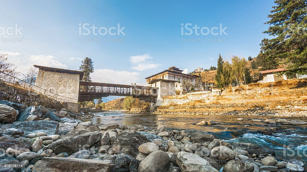 The bridge across the river with traditional bhutan palace stock photo