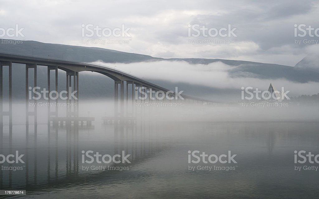 The bridge in a morning fog. royalty-free stock photo