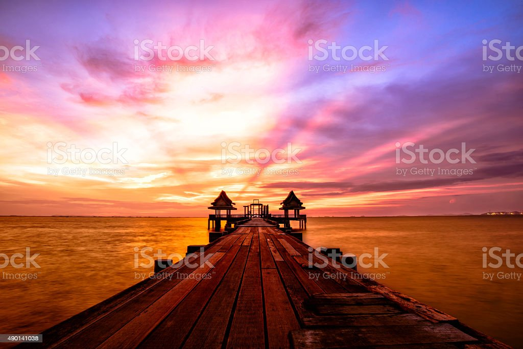 The Bridge in to the sea with sunset stock photo