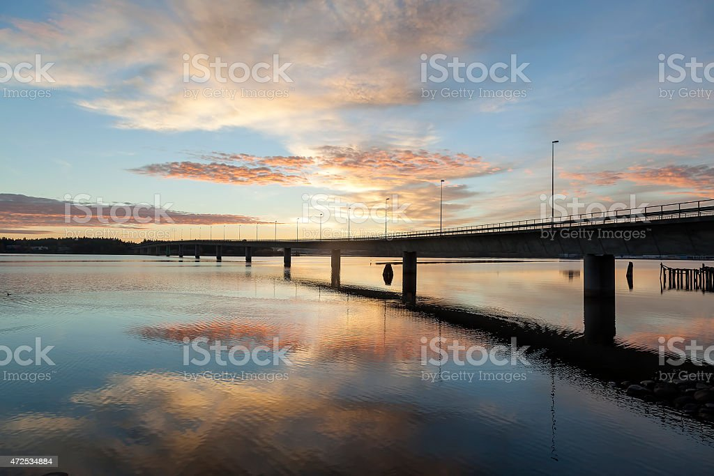 The bridge with reflections in water and sunrise royalty-free stock photo