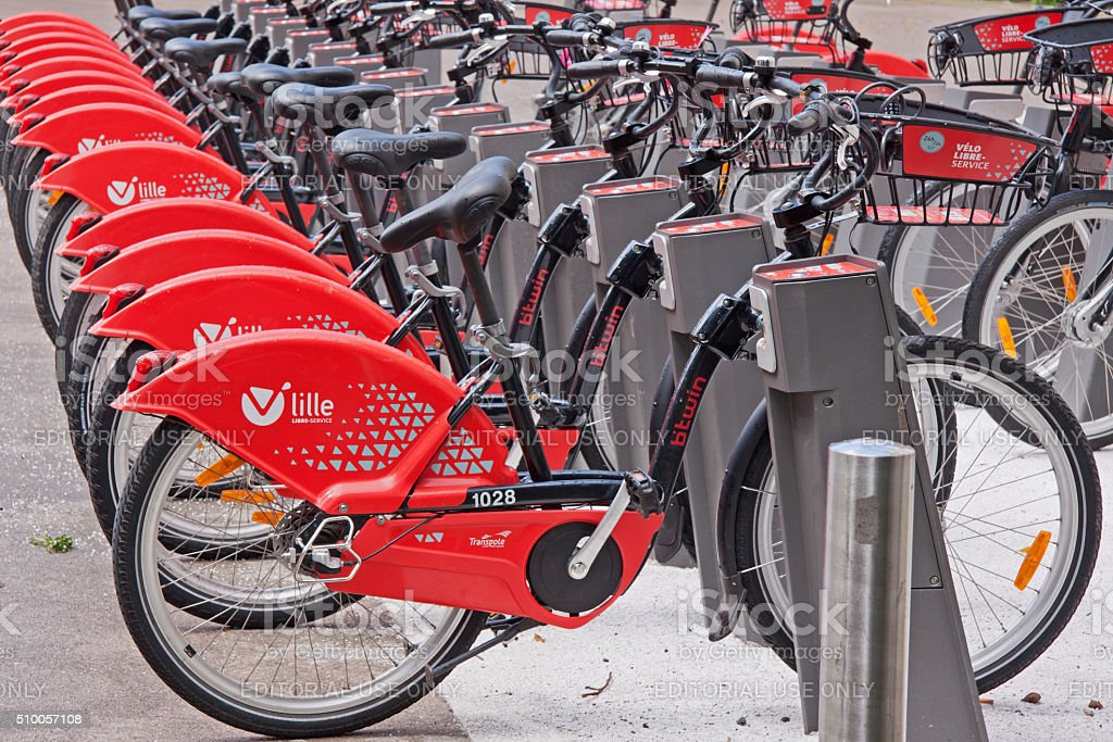 The bright red public bicycles of Lille, France stock photo