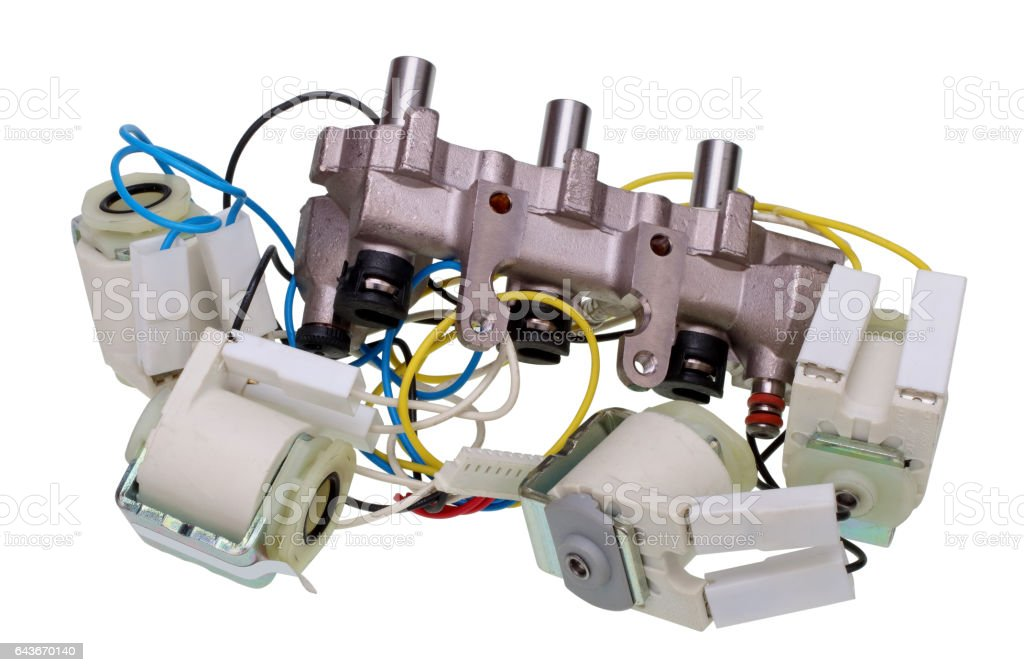 The broken artificial heart of the mechanism concept. Valves, wires  and steel pipes and  hoses as blood vessels.Isolated stock photo
