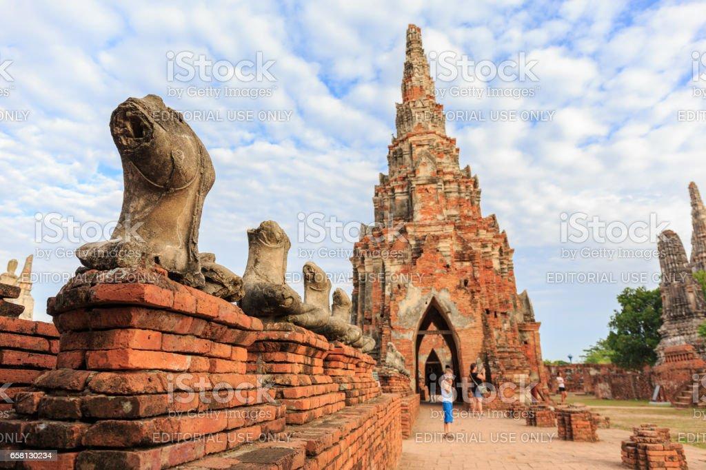 AYUTTHAYA, THAILAND – MAY 25, 2017 : The broken Buddha statues and tourisms  in Wat Chaiwatthanaram  Buddhist temple in the city of Ayutthaya Historical Park at Ayutthaya,Thailand. stock photo