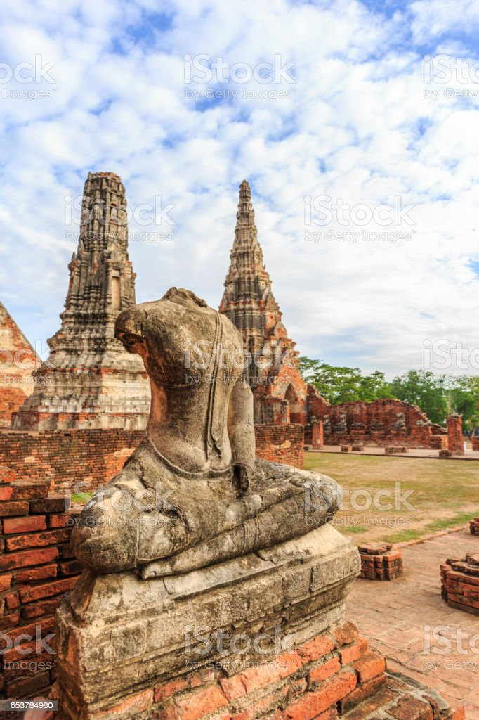 The broken Buddha statues on old brick wall in Wat Chaiwatthanaram Buddhist temple in the city of Ayutthaya Historical Park at Ayutthaya,Thailand stock photo