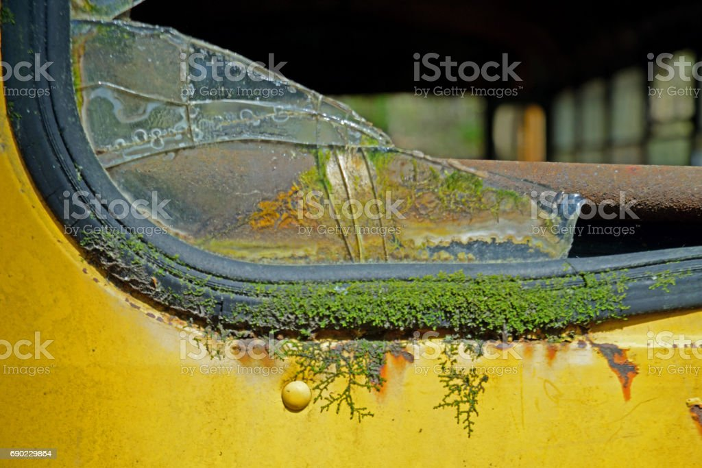 The broken glass in the back of a school bus close up. stock photo