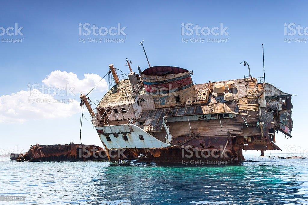 The broken ship at sea stock photo