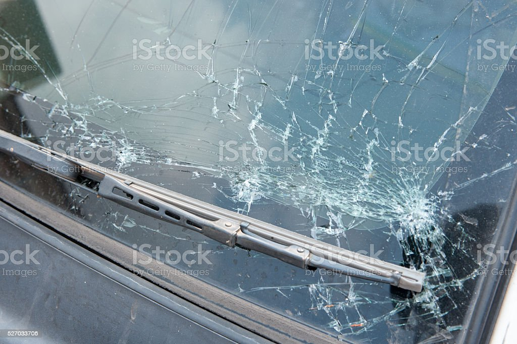 The broken windshield in car accident stock photo