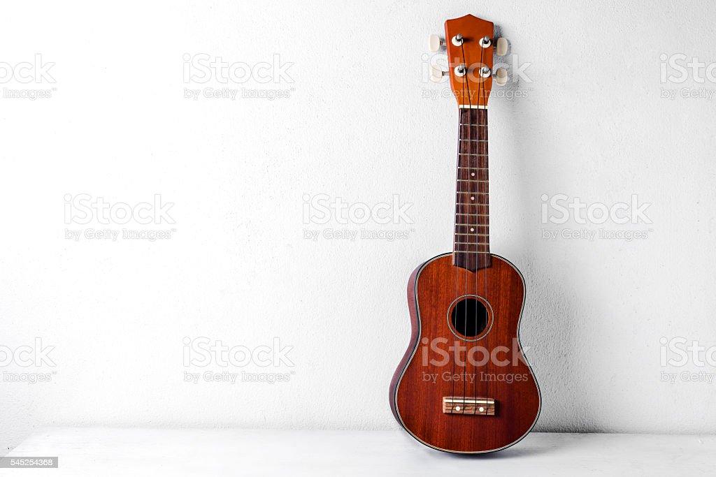 The brown ukulele stock photo