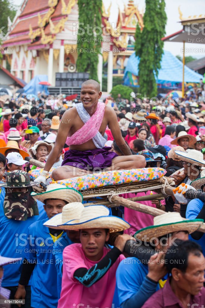 The Brutal Ordination Parade a New Monk or Priest. stock photo