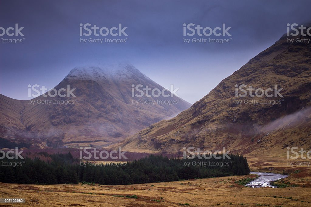 The Buachaille Disappearing into Cloud stock photo