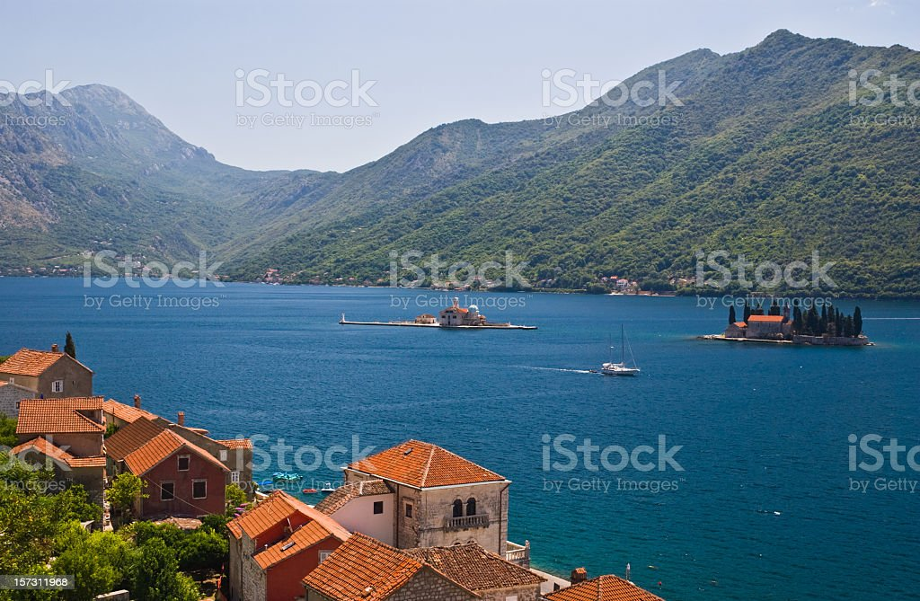 The buildings, mountains and Kotor Bay in Perast, Montenegro royalty-free stock photo
