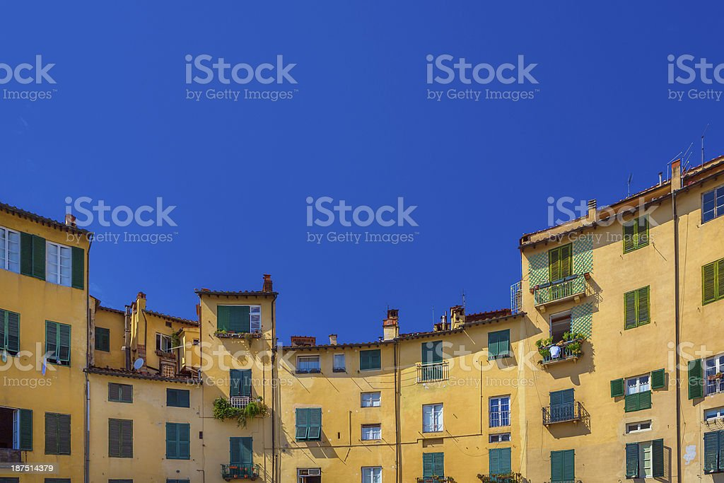 The buildings of Piazza dell'Anfiteatro in Lucca, Tuscany stock photo