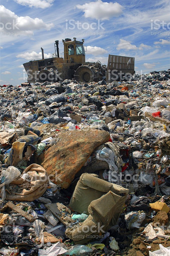 The bulldozer on a garbage dump stock photo